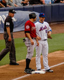 David Wright and Lance Berkman talk at third base. Royalty Free Stock Images