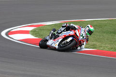 Davide Giugliano #34 auf Fabrik 1000 Aprilia RSV4 mit Althea Racing Team Superbike WSBK Lizenzfreie Stockfotografie
