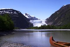 Davidson Glacier. Canoe and Davidson Glacier, Alaska stock photography