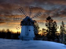 Davidson Windmill Sunrise. Built by Finnish immigrants to northwestern Wisconsin, the Davidson Windmill watches down over the Amnicon River on a cold winter day Stock Image