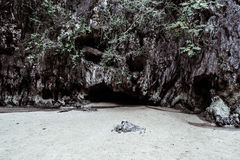 Davil's cave. Cave shaped like a devilish face at an island in Thailand Royalty Free Stock Image