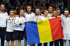 Davis Cup, the Romanian players are celebrating the victory with the Romanian flag Royalty Free Stock Photo