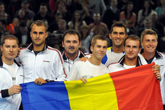 Davis Cup, the Romanian players are celebrating the victory with the Romanian flag Stock Image