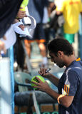 Davis Cup tennis tournament, Cyprus against Benin. NICOSIA, CYPRUS - APRIL 5:   Marcos Baghdatis  signs on a ball on Davis Cup tennis tournament between Cyprus Stock Photography