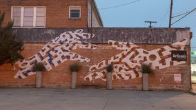 Davis Street Hands Mural, Bishop Arts District, Dallas, Texas. Pictured is a mural of outstretched hands, reaching for each other, on Davis Street in the Bishop stock photos