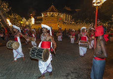 Davul Players perform infront of the Temple of the Sacred Tooth Relic in Kandy, during the Esala Perahera. Stock Photos