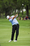 Dawie Van Der Walt. Clubbing the ball up the 1st fairway, toward the green Royalty Free Stock Photos