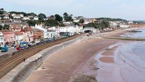 Dawlish Девон Англия с железнодорожным путем и морем стоковые фото