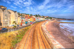 Dawlish Devon England with beach railway track and sea on blue sky summer day in HDR. Dawlish Devon England with beach railway track and sea on blue sky summer Stock Images
