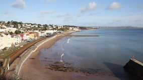 Dawlish Devon England uk train travelling on coast railway track. Train travelling through Dawlish Devon England uk English coast town with beach railway train stock footage