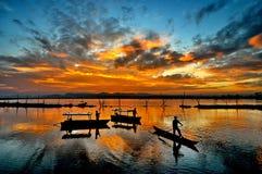 Dawn. Three traditional fishermen in Rawa Pening Lake,Am,barawa,Central Java Stock Photos