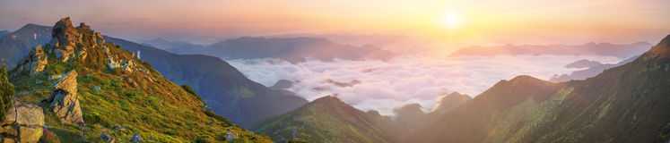 Dawn above the sea of fog Stock Photography