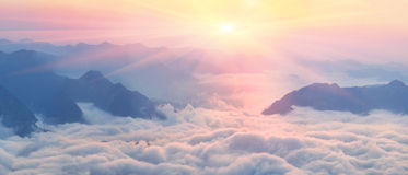 Dawn above the sea of fog Stock Image