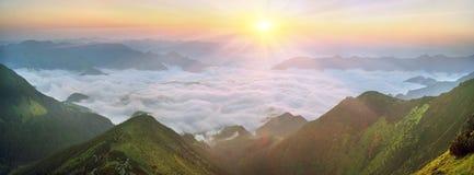 Dawn above the sea of fog Stock Photo
