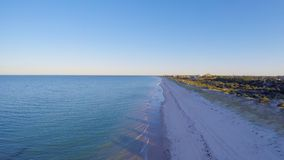 Dawn aerial view of South Australian beach with sun rising over Adelaide. Early morning drone aerial view of South Australian beach with sun rising over Adelaide Royalty Free Stock Photo