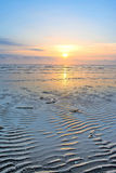 Dawn Beach. At Theddlethorpe near Mablethorpe, Lincolnshire at low tide with single post Stock Photos
