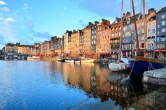Dawn at Honfleur harbor with boats and reflections, France stock photography