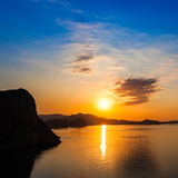 Dawn at Black sea. Morning seascape with mountains. Crimea Royalty Free Stock Photography