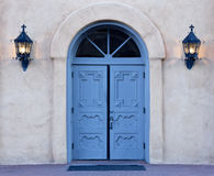 Dawn on blue doors of Albuquerque church. Morning rays begin to illuminate the azure blue, double doors of San Felipe de Neri church in Old Town, Albuquerque Royalty Free Stock Photography