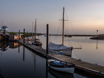 Dawn with Boats in Harbour Royalty Free Stock Image