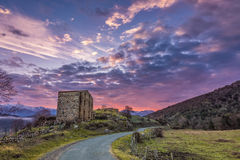 Dawn breaking over old farm building in Corsica Stock Images