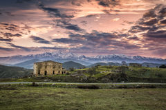 Dawn breaking over old farm buildings in Corsica Royalty Free Stock Photo