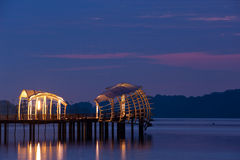 Dawn breaking over pier Royalty Free Stock Photography