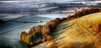 Dawn breaking over wrinkled hill - South Downs - UK Royalty Free Stock Image