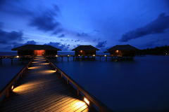 Dawn at bridge water bungalows in Maldives. Stock Image
