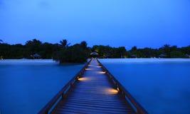 Dawn at bridge water bungalows in Maldives. Serene water shot Stock Image