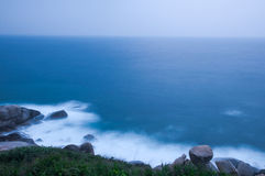 The dawn of calm ocean. With long exposure taken in Wuzhizhou Island of Sanya City, Hainan Province,china Stock Photos