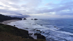 Dawn at Cannon Beach. Morning surf around Cannon Beach Royalty Free Stock Photography