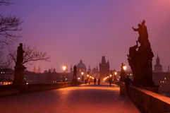 Dawn on Charles Bridge in Prague Stock Images