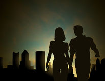 Dawn city. Editable silhouette of a couple walking in a city at dawn or dusk with sky made using a gradient mesh vector illustration