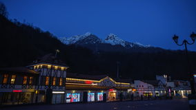 Dawn in the city of lights mountain peaks. Public illumination is turned off when the first rays of the sun falling on the mountain tops stock video