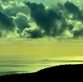 Dawn with clouds and ship on the sea. Coastal dawn with clouds and ship on the sea Stock Images