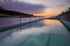 Dawn at Clovelly Pool Sydney. Winters dawn long exposure at Clovelly Beach Ocean Pool in Sydney's Eastern subuirbs.  218 seconds Royalty Free Stock Photo