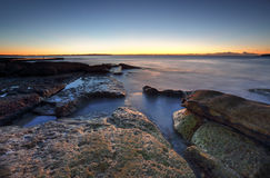 Dawn coast on the rocks at Cronulla, Australia Royalty Free Stock Images