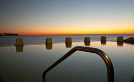 Dawn at Coogee Tidal Pool. Dawn over the ocean pool at Coogee Sydney Australia Royalty Free Stock Photos
