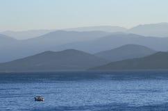 Dawn in Corfu Greece. Hazy morning in corfu on the ionian sea; long telephoto perspective Stock Image