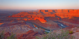 Dawn at Dead Horse Point. Looking down into river canyon lit by early morning sun royalty free stock image