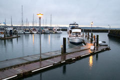 Dawn at Des Moines marina. Des Moines, WA, USA Jan. 22, 2017: Pleasure boats moored at Des Moines marina Stock Photo