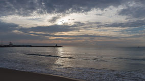 Dawn in El Campello. Beautiful promenade at the beach at sunrise El Campello Stock Images