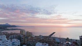 Dawn in El Campello. El Campello - October 3, 2015: Early morning sunrise on ipanskom tourist Costa Blanca 3 October 2015 El Campello, Costa Blanca, Spain Stock Photography