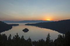 Dawn at Emerald Bay, Lake Tahoe, California. Sunrise over Emerald Bay in Lake Tahoe, California over pine forest banks Stock Image