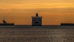 Dawn Ferry Heads to Sea. A ferry leaves the port of Dover in the early dawn, bound across the English Channel for France Stock Image