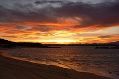 Dawn of fire on the Bay. Dawn of fire on the Santander Bay (Spain royalty free stock photos