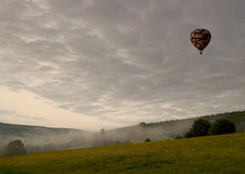 Dawn Flight. Of a hot air balloon over English stately house parkland in the Peak National Park, UK Stock Photos