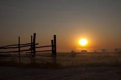 Dawn in a fog. Solar dawn in a fog on a farm Stock Image