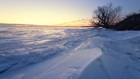 Dawn at the frozen lake shore Royalty Free Stock Image